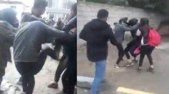 Iğdır'da iki grup liseli kız öğrenci, okul çıkışı saç saça, baş başa kavga etti. Kavga, erkek öğrenc