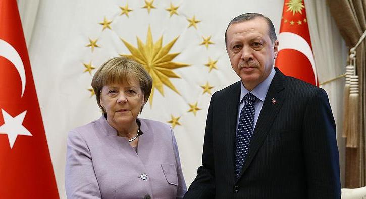 Cumhurba%C5%9Fkan%C4%B1+Erdo%C4%9Fan+Merkel+ile+telefonda+g%C3%B6r%C3%BC%C5%9Ft%C3%BC+